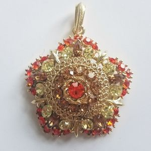 Lisner large flower rhinestone gold tone pendant